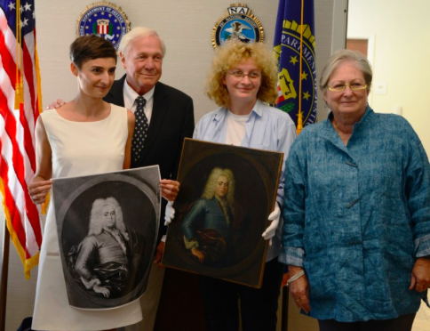 The FBI helped recover a Polish paiinting stolen by Nazi soldiers during WWII. John Bobb and Janis Bobb (right) returned Krzysztof Lubieniecki's Portrait of a Young Man to Polish officials during a repatriation ceremony at the FBI's office in Columbus, Ohio in September 2015
